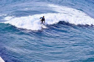 mission beach surfer - Scenic Cycle Tours - San Diego Bike Tours