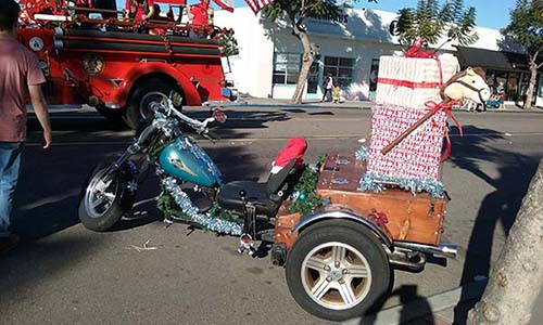 pb christmas parade santa's sleigh - San Diego Scenic Cycle Tours