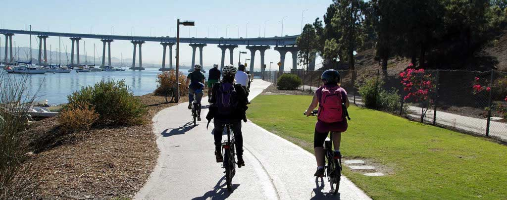 Riding under Coronado bridge - San Diego Scenic Cycle Tours